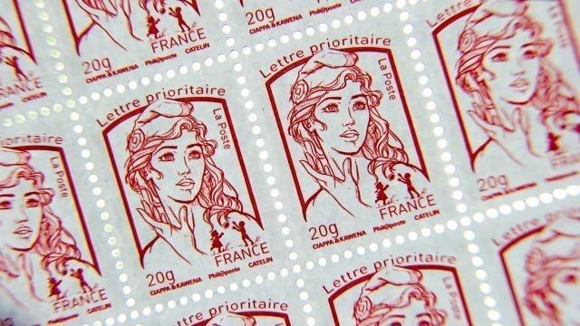 photo les tarifs du courrier augmenteront de 3,6% au 1er janvier, le timbre rouge porté à 80 centimes © afp